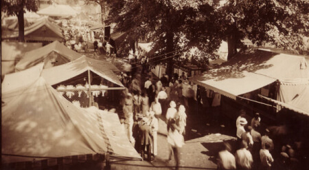 fair tents and people